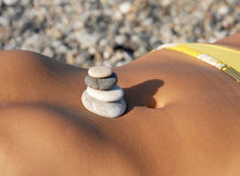 Rocks stack on stomach Stock Photos
