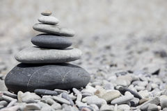 Rocks stacked on the beach Stock Image
