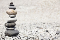Rocks stacked on the beach stock photography