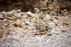 Rocks stacked on the Livadi beach on Thassos Island, Greece Stock Photography