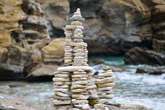 Rocks stacked on the Livadi beach on Thassos Island, Greece Royalty Free Stock Images