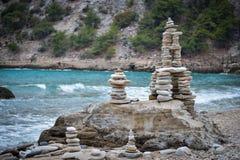 Rocks stacked on the Livadi beach on Thassos Island, Greece Royalty Free Stock Photo