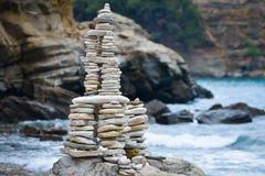 Rocks stacked on the Livadi beach on Thassos Island, Greece Royalty Free Stock Photos