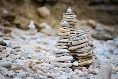 Rocks stacked on the Livadi beach on Thassos Island, Greece Stock Photos