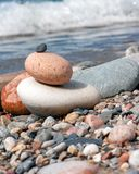 Rocks stacked on stony beach stock photos