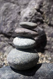 Rocks stacked on top of each other: balance. Balance: rocks that are stacked on top of each other on the beach stock photo