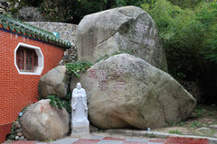 The rocks and statue of Chinese Dongmingsi. The rocks and statue of Chinese fujian Dongmingsi Royalty Free Stock Images