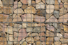 Rocks in a steel net Stock Image