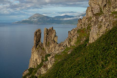 Rocks on a steep slope above the sea. Royalty Free Stock Photos