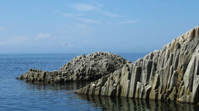Rocks in Stolbchatiy cape, Kunashir royalty free stock photos