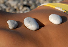 Rocks  on stomach Stock Photo