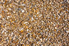 Rocks and Stone beach pattern closeup, Summer seacoast background.  stock images