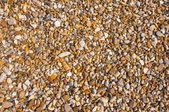 Rocks and Stone beach pattern closeup, Summer seacoast background.  royalty free stock image
