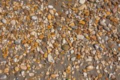 Rocks and Stone beach pattern closeup, Summer seacoast background.  stock photos