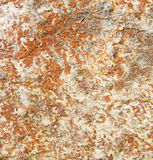 Rocks stone a nd red orange gneiss in the wall of morocco. Rocks stone and red orange gneiss in the wall of morocco Stock Image