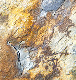Rocks stone and red    orange gneiss in the wall of morocco Stock Photo