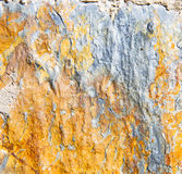 rocks stone and red     orange gneiss in the wall of morocco Royalty Free Stock Photo