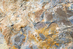 Rocks stone and red orange gneiss in the. Wall of morocco Stock Image