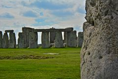 Rocks of Stonehenge On a Cloudy Summer Day, Textured Stone. In Foreground stock image