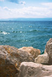 Rocks and stones with Adriatic sea in background Stock Image