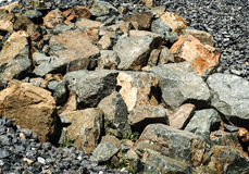 Rocks stones boulders peebles coloured Stock Photos