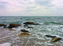 Rocks and stones on shallow water. Seascape with rocks and stones on shallow water Royalty Free Stock Images