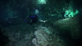 Rocks and stones of Yucatan cenotes underwater in Mexico. Scuba diving in clean water of caves stock video