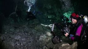 Rocks and stones of Yucatan cenotes underwater in Mexico. Scuba diving in clean water of caves stock video footage
