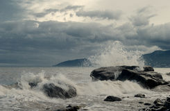 Rocks in stormy sea Royalty Free Stock Images