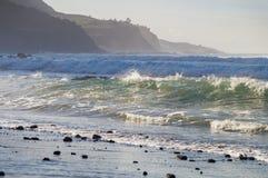 Rocks and stormy waves on Playa El Socorro beach Royalty Free Stock Photos