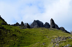 Rocks of The Storr in Scotland. Towering rocks on the hiking trail at Old Man of Storr in Scotland Stock Photos
