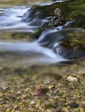 Rocks in a stream. Moss-covered rocks in a stream Royalty Free Stock Photo