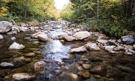 Rocks in a stream Stock Photos