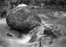 Rocks in a stream - shot with analogue film. Rocks in a stream taking with a long exposure. Location: Uddevalla, Sweden. Image is taken with a full-frame stock image