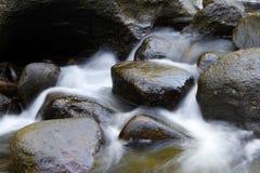 Rocks in stream. Water flowing between rocks in stream Royalty Free Stock Photos