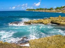 Guadeloupe north coast. Rocks and strong waves crashing on rocks in the wild north coast of Guadeloupe, Caribbean, French West Indies Royalty Free Stock Photos