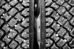 Rocks stuck in tire treads Stock Photos