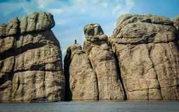 Rocks on Sylvan Lake in Custer State Park. Rocks and accomplished climber at Sullivan Lake in Custer State Park in South Dakota royalty free stock photo