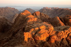 Rocks in the sun of early morning. Panorama rocks of Mount Sinai in early morning stock photography