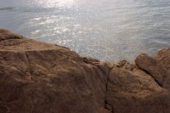 Rocks and sunlit sea Royalty Free Stock Images