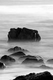 Rocks in Surf (Black and White) Royalty Free Stock Photography