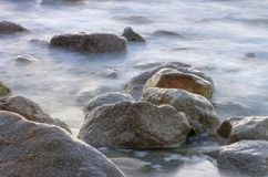 Rocks in surf Stock Photography