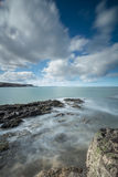 Rocks and Swirling Tide at Penmon Point, Anglesey. Stock Images