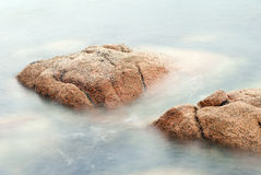 Rocks in swirling water Stock Images