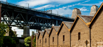 The Rocks, Sydney, Australia. The Rocks houses and Harbour Bridge Sydney, Australia Royalty Free Stock Photo