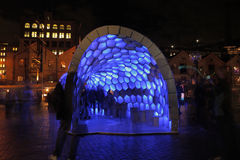 People enjoying Cellular Tessellation The Rocks S. THE ROCKS, SYDNEY, AUSTRALIA - JUNE 2, 2014; People enjoying Cellular Tessellation during Vivid Sydney Stock Photography