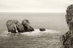 Rocks in te ocean water at sunset. Cantabria, Spain Royalty Free Stock Images