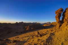 Rocks on the Teide volcano in the light of the rising sun Stock Photos