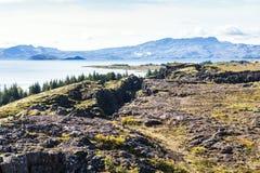 Rocks and Thingvallavatn lake in Thingvellir park Royalty Free Stock Images