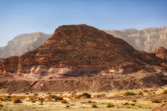 Rocks in Timna valley, Israel. Sunlit rock formations in Timna national park, Israel Stock Photo